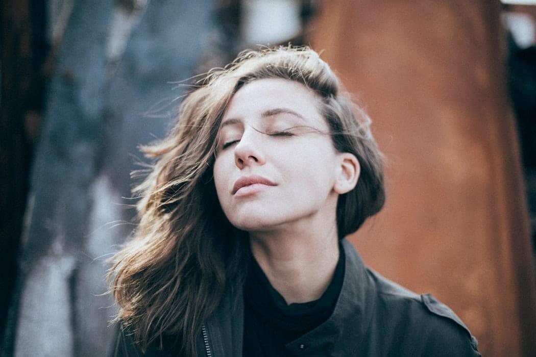 Woman breathing in outside.